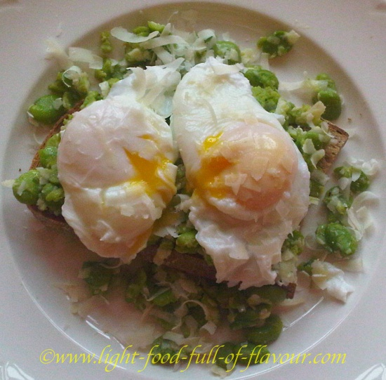 Broad Beans (Fava Beans) And Poached Eggs On Sourdough Bread